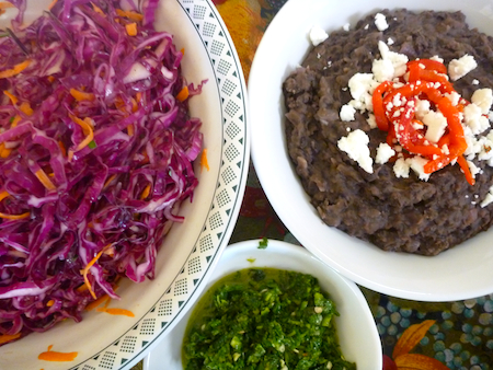 Refried black beans red cabbage slaw and zhoug