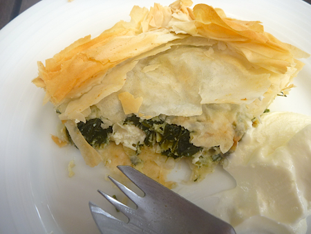 spanakopita on plate with yoghurt