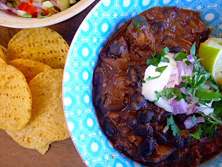 Vegetarian black bean chilli with fresh salsa and tortilla chips