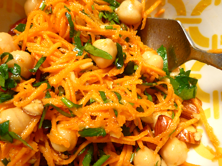Close up Spiced carrot salad with fried almonds