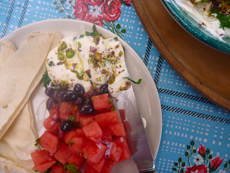 Labneh dip with watermelon salad, olives and flat bread