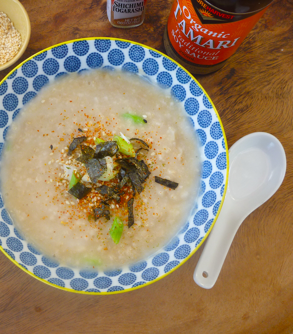 savoury porridge with soy sauce, green onions, sesame seeds and nori
