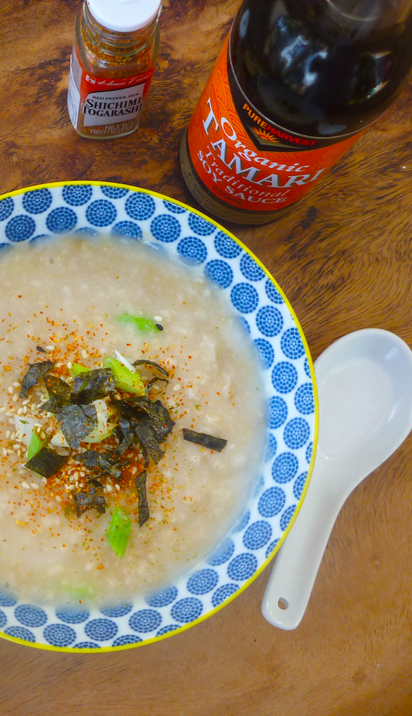 Savoury porridge with soy sauce, green onions, toasted sesame seeds and nori