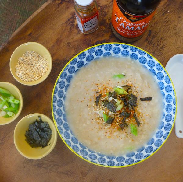 Savoury porridge with spring onions, soy sauce, sesame seeds and nori