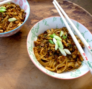 Vegetarian dan dan noodles with tofu and mushrooms