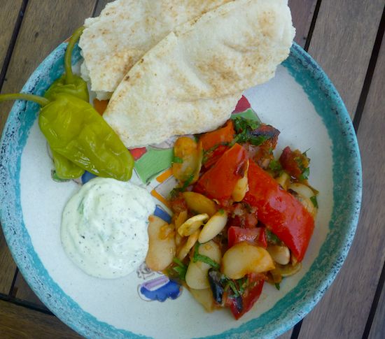 Greek vegetarian baked beans with tzatziki, pickles and bread.