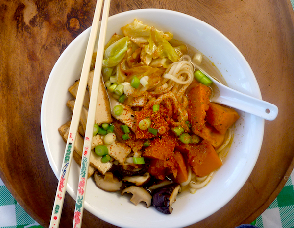 Udon noodle miso soup with pumpkin, cabbage and mushrooms