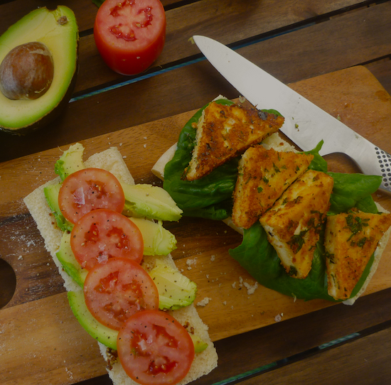Herb crusted tofu schnitzel sandwich