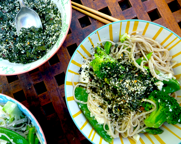 Asian green salad with tofu, noodles and sesame sprinkle