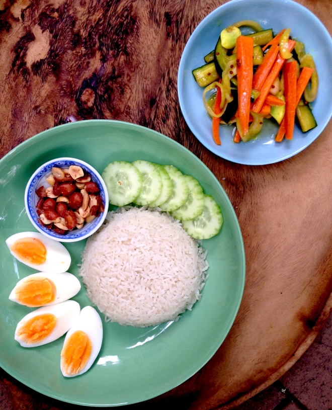 Nasi lemak - fragrant coconut rice with boiled egg and quick carrot pickle